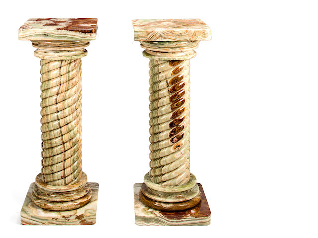 A pair of large vert de mer marble columns, 20th century