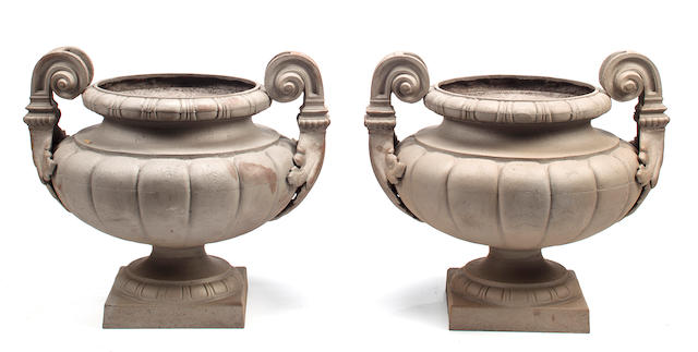 A pair of cast iron garden urns, France or America, late 19th to early 20th century