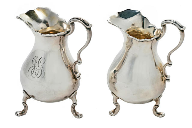 Two matching American sterling silver Queen Anne style cream jugs manufactured and retailed by Tiffany & Co., New York, NY, 1891-1902