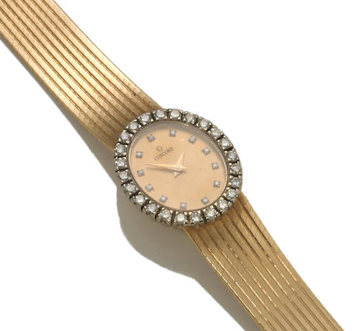 A diamond and fourteen karat gold integral bracelet wristwatch, Concord