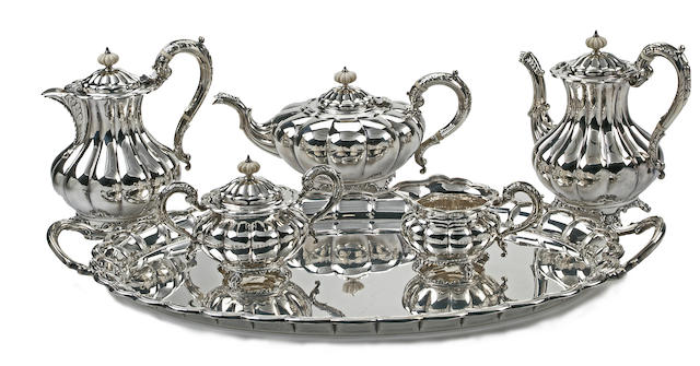 A sterling silver six piece tea and coffee service comprising two coffe pots, one tea pot, one creamer, one sugar bowl with lid and matching tray by Mappin & Webb, Birmingham, early 20th century