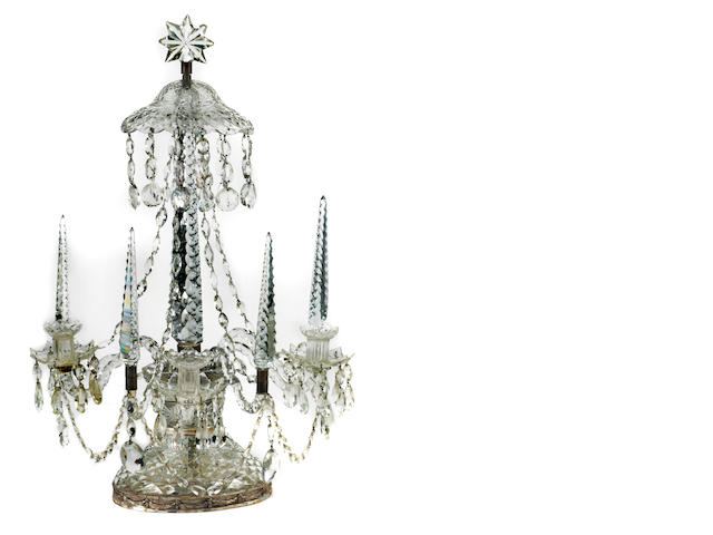 A Victorian cut glass candelabrum in the style of George III, with old repair