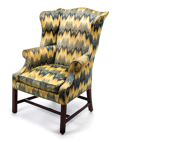 A Chippendale mahogany upholstered wing chair