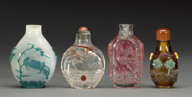 A group of four overlay glass snuff bottles