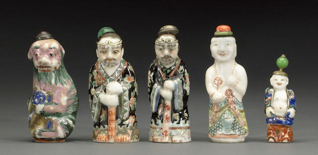 A group of five molded porcelain figural bottles