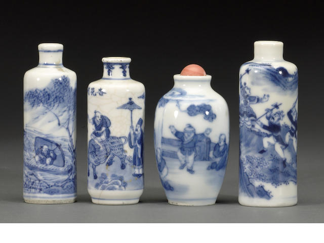 A group of four blue and white porcelain snuff bottles