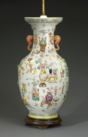 A famille rose enameled porcelain baluster vase with raised relief decoration Republic period