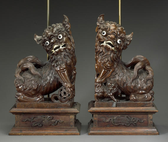 A pair of carved wood lion dogs Republic period