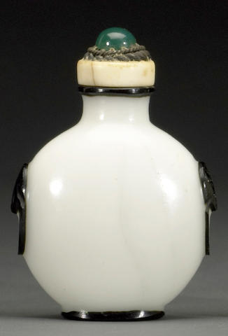 A white glass snuff bottle with black overlay decoration 1820-1880