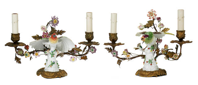 A pair of Louis XV style gilt bronze mounted porcelain two light candelabra<BR />second half 19th century