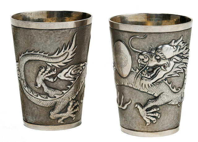 A pair of Chinese Export parcel gilt silver beakers