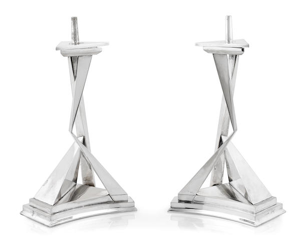 A pair of Salvador Dali chromium plated metal pricket candlesticks: L'immortaliti de Castor et Pollux  circa 1975