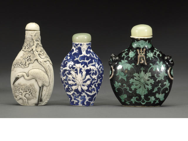 A group of three porcelain snuff bottles