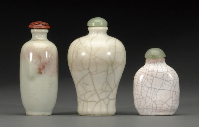 A group of three glazed ceramic snuff bottles