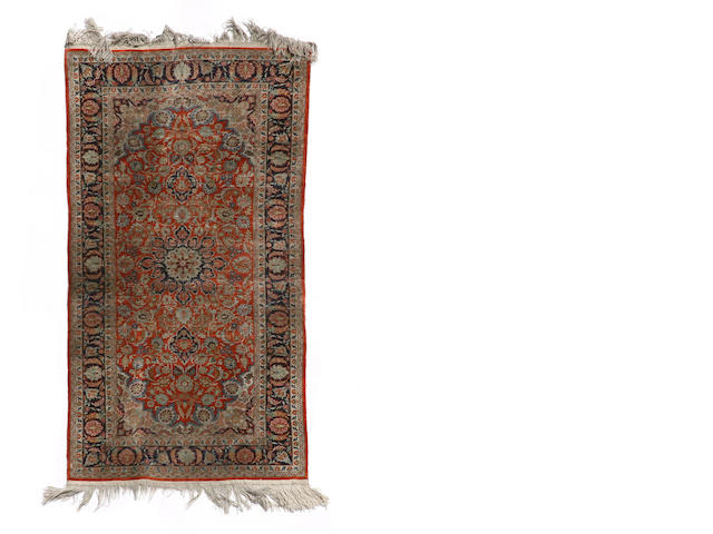 A Chinese carpet size approximately 6ft. 1in. x 9ft. 1in.