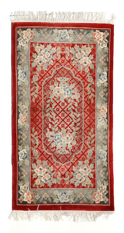A Chinese rug size approximately 3ft. x 5ft.