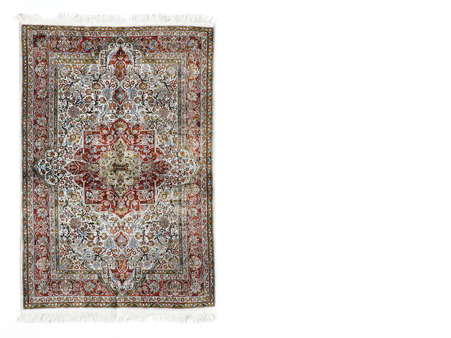 A Kashmiri rug size approximately 4ft. x 6ft.