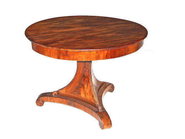 A Biedermeier mahogany center table circa 1840