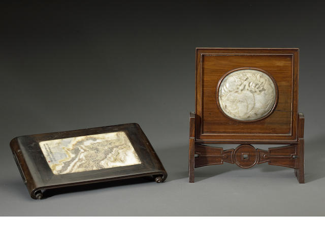 A ovoid jade plaque set in a small table screen
