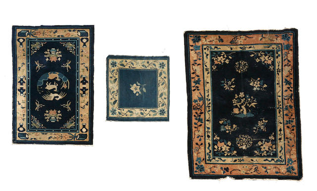 A Chinese rug size approximately 2ft. x 2ft. 3in. and size approximately 4ft. x 6ft.