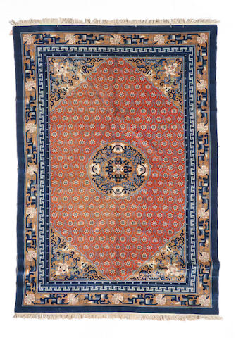 A Chinese carpet size approximately 6ft. x 9ft.