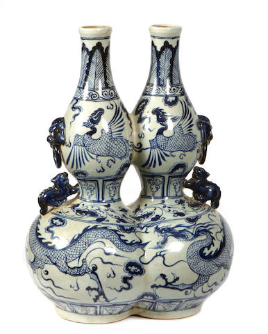A pair of Chinese blue and white double gourd form vases
