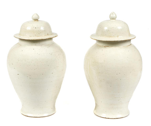 A pair of Chinese covered vases