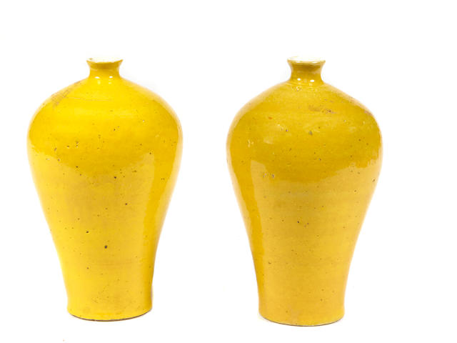 A pair of Chinese yellow glazed porcelain vases