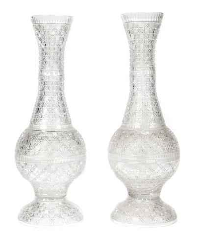 A large pair of Regency style cut glass vases
