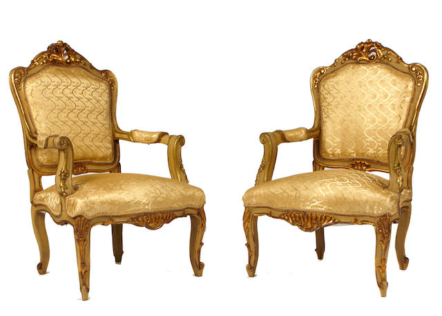 A pair of Italian Rococo style paint decorated armchairs