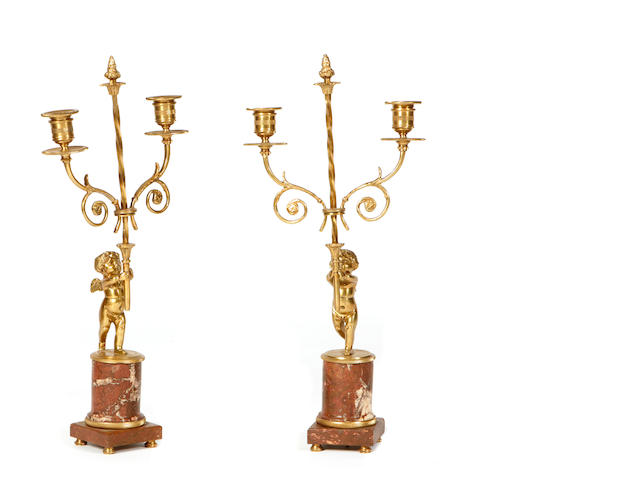 A pair of Louis XVI style gilt bronze and marble candelabra