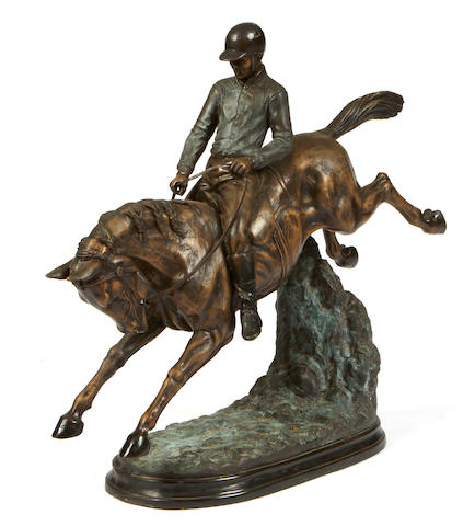 A patinated bronze figure of equestrian interest