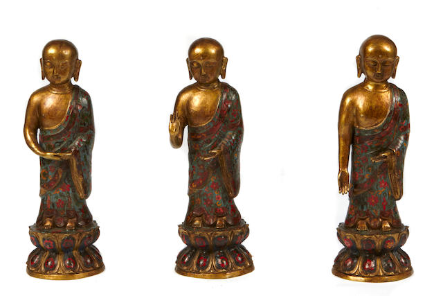 A set of three paint decorated figures of wise men