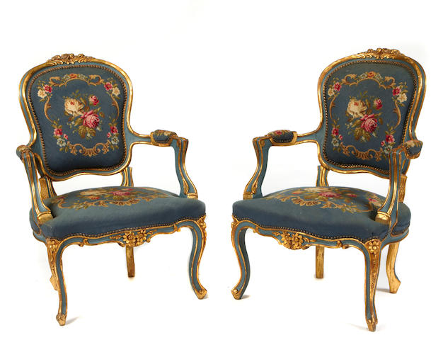 A pair of Louis XV style needlepoint upholstered armchairs