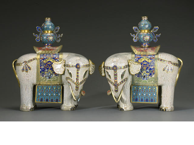 A pair of Chinese elaborately caparisoned and saddled cloisonné elephants surmounted by vases, 'Taiping Youxiang'  Late Qing/Republic Period