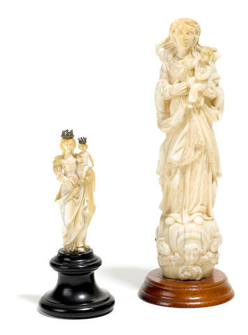 A group of two carved ivory figures of the Madonna and Child