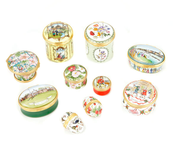 A group of twenty three Halcyon Days enamel boxes
