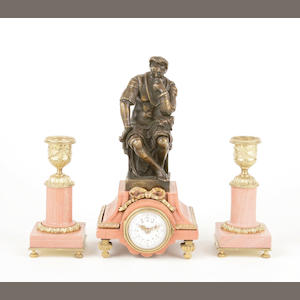 An assembled French gilt bronze and marble three piece miniature clock garniture