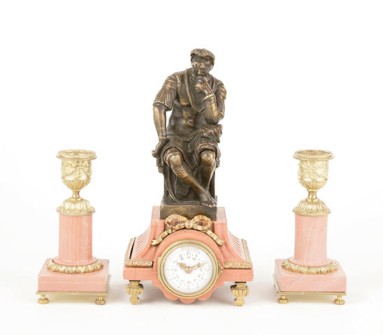 An assembled French gilt bronze and marble miniature clock garniture
