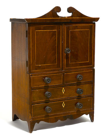 A Federal inlaid mahogany miniature linen press  early 19th century