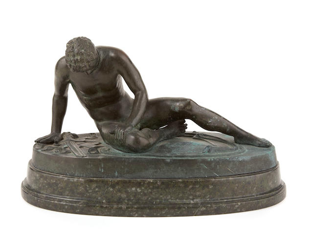 An Italian patinated bronze figure on marble base