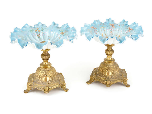 A pair of WMF gilt metal and enameled glass compotes