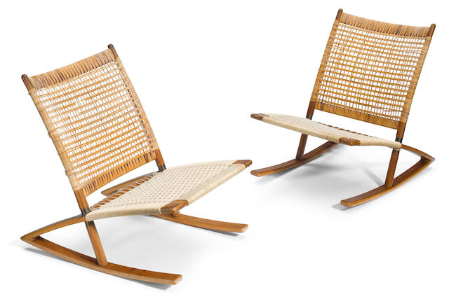A pair of Scandinavian teak and caned rocking chairs mid 20th century