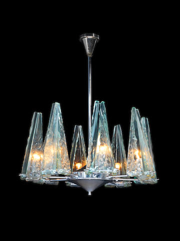 An eight arm chandelier with 'chiselled' and polished glass elements  Fontana Arte, Italian c 1955