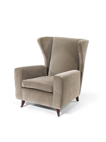 A Wingback Armchair Italian, circa 1950  stained beech with velvet upholstery  Height: 37 in. 94 cm.