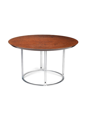 Preben Fabricius and Jørgen Kastholm A Dining Table circa 1965  stained maple and steel  Height: 27 15/16 in.                71 cm.  Diameter: 49 3/16 in.                  125 cm.