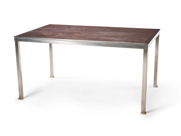 Guy Lefevre A Centre Table circa 1960  suede top set within a chromed metal base  29 15/16 x 59 7/16 x 37 13/16 in. 76 x 151 x 96 cm.