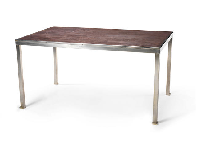 A leather topped table with nickeled metal base  Guy Lefevre, French c 1960