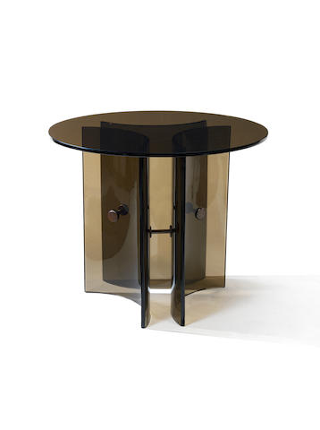 A dark glass occasional table with curved glass legs and gilt metal mounts Fontana Arte, Italian c 1960