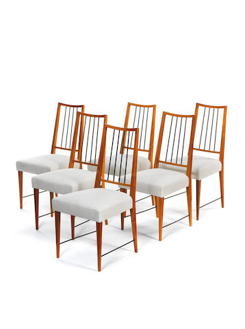 Eva and Karl Mang A Set of Six Dining Chairs  circa 1955  walnut with fabric upholstery  Height: 37 in. 94 cm.